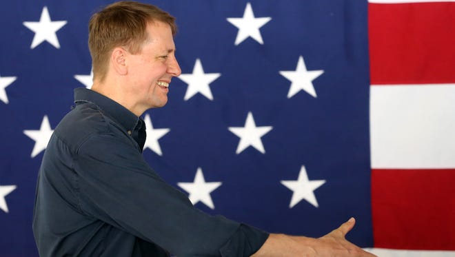 Consumer Financial Protection Bureau (CFPB) Director Richard Cordray is introduced before delivering remarks during the 2017 Cincinnati AFL-CIO Labor Day Picnic, Monday, Sept. 4, 2017, at Coney Island.
