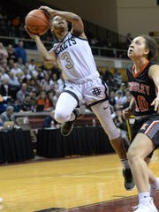 DCD senior Jasmine Powell, shown driving to the hoop in last year's state semifinal win over Kingsley, averaged 12.5 points and a team-leading 4.5 assists per game during the 2017-18 season.