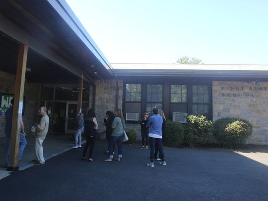 Parents wait to pick up their children at the Ridge
