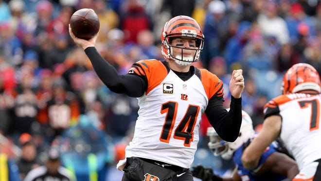 Orchard Park, NY, USA; Cincinnati Bengals quarterback Andy Dalton (14) throws a pass during the second half against the Buffalo Bills at Ralph Wilson Stadium. Bengals beat the Bills 34 to 21.