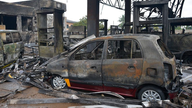 Destroyed vehicles at the scene of a petrol station fire in the capital Accra, Ghana on Thursday.