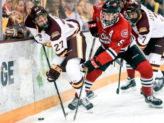 Minnesota Duluth left wing Riley Tufte (27) competes