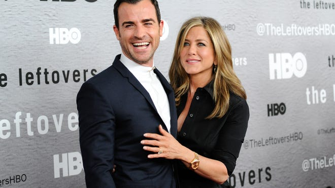"Actors Jennifer Aniston, right, and Justin Theroux attend HBO's ""The Leftovers"" season premiere at the NYU Skirball Center on Monday, June 23, 2014 in New York. (Photo by Evan Agostini/Invision/AP) ORG XMIT: NYEA202"