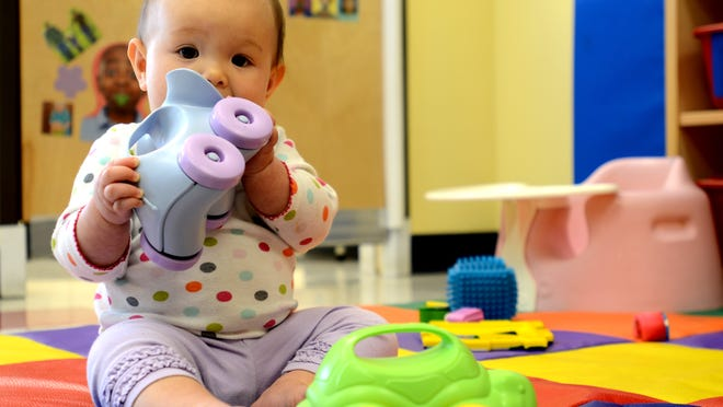 Victoria Evangelista, 9 months, plays with a toy submitted to The Goddard School in Sparks, one among 50 schools to participate in toy testings, on Monday, Oct. 6, 2014.