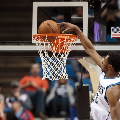 Mar 30, 2015; Minneapolis, MN, USA; Minnesota Timberwolves guard Andrew Wiggins (22) dunks in the fourth quarter against the Utah Jazz at Target Center. The Utah Jazz beat the Minnesota Timberwolves 104-84. Mandatory Credit: Brad Rempel-USA TODAY Sports