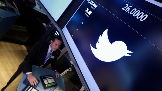Specialist Glenn Carell, who will handle the Twitter IPO, works at his post on the floor of the New York Stock Exchange.