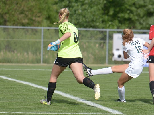 Avery Fenchel (15) drives the game winning goal past