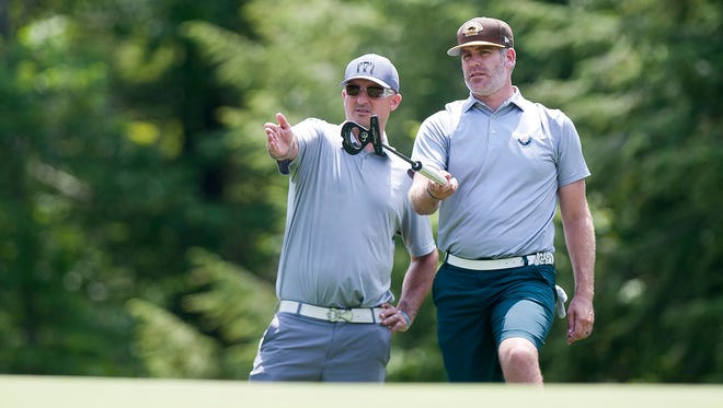 Garren Poirier, right, and his caddie size up a birdie putt on the par-3 17th hole during the second round of the Vermont Amateur on Wednesday at Dorset Field Club.
