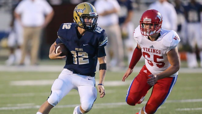 Pearl's Jake Smithhart is chased by Warren Central's Zane Mcraney during their game on Friday night in Pearl.