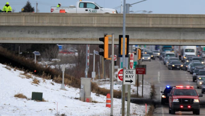 Grand Chute police and fire at US 41 and College Ave. where a 38-year-old construction worker suffered minor injuries after falling from the US 41 overpass around 2 p.m. on December 4, 2014, in Grand Chute, Wis. 