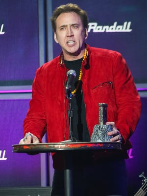 Actor Nicolas Cage speaks on stage at the 6th Annual Revolver Golden Gods Award Show at Club Nokia on April 23, 2014 in Los Angeles, California. (Photo by Paul A. Hebert/Invision/AP)