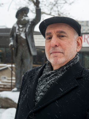 Author David Friedman stands near the Walt Whitman statue on the Rutgers-Camden campus. Friedman is the author of 'Wilde in America,' a book on Oscar Wilde that details Wilde's meeting with Whitman in Camden.