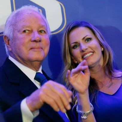 Former Louisiana governor Edwin Edwards waves with his wife Trina Scott Edwards as they arrive onstage with family and supporters for Louisiana Gov.-elect John Bel Edwards, at his election night watch party in New Orleans, Saturday, Nov. 21, 2015. John Bel Edwards won the runoff election for Louisiana governor Saturday, defeating the once-heavy favorite, Republican David Vitter, and handing the Democrats their first statewide victory since 2008. (AP Photo/Gerald Herbert)
