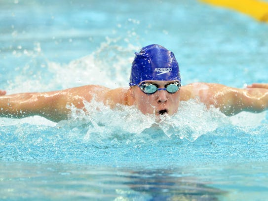 Sartell-St. Stephen's Spencer Sathre competes in the