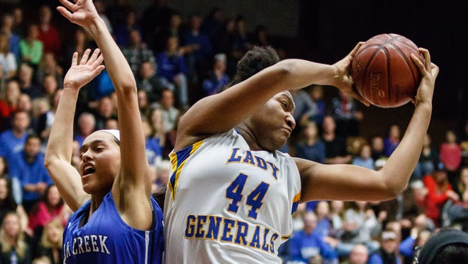 Rufus King junior Sydnee Roby (44) steals a rebound from Oak Creek's Kassandra Bartek (21) during the WIAA Division 1 sectional final at West Allis Central on Saturday, March 3, 2018.