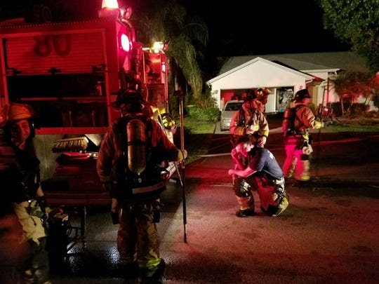 Firefighters battle a house fire Saturday night in