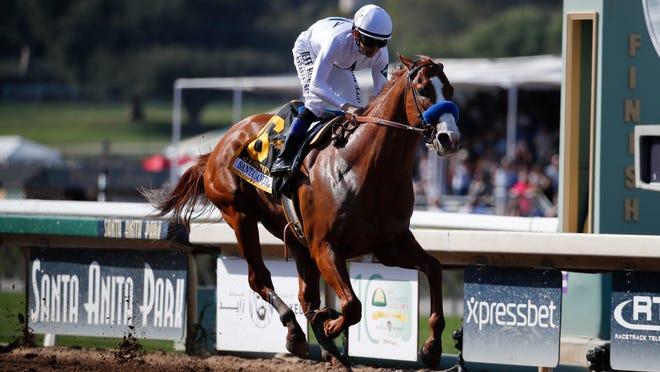 Justify, ridden by Mike Smith, crosses the finish line to win the Santa Anita Derby horse race at Santa Anita Park, Saturday, April 7, 2018, in Arcadia, Calif. (AP Photo/Jae C. Hong)