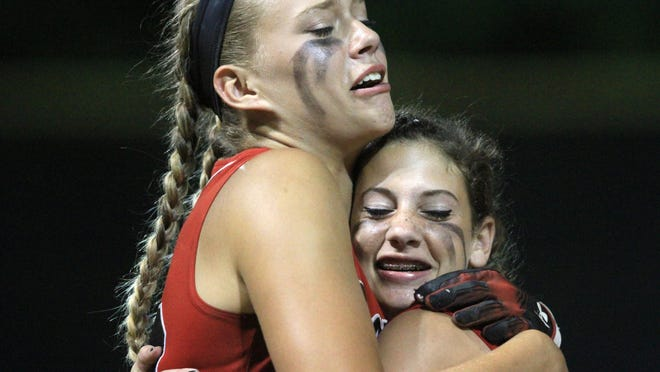 Coventry's Alyssa Derrick, left, and Mackenzie Ricci celebrate their win    over North Kingstown in a Division II championship softball game in June 2015. Derrick has signed with the Houston Stampede, a franchise in the Women's Football League Association, where she hopes her talent for throwing the football will be utilized.