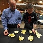 Volunteers count ballots during the Republican caucuses in Des Moines in 2012.