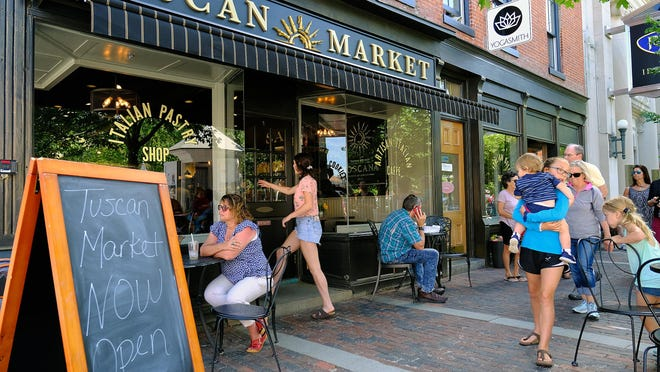 The Portsmouth City Council on Thursday approved a revised plan for alcohol service by Tuscan Market, while maintaining public use of nine cafe tables in Market Square.