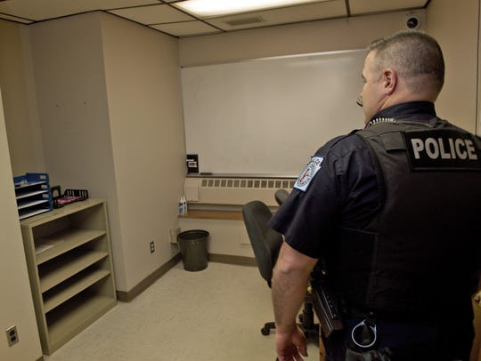 Officer Mark Taylor enters the interview room Wednesday,