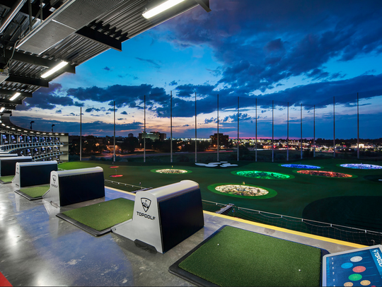 A view of the hitting bays at the Atlanta Topgolf location
