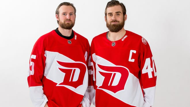 Niklas Kronwall and Henrik Zetterberg model the Red Wings Stadium Classic jerseys.