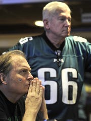 Chad Chandler, of Wilmington, watches as Eagles face
