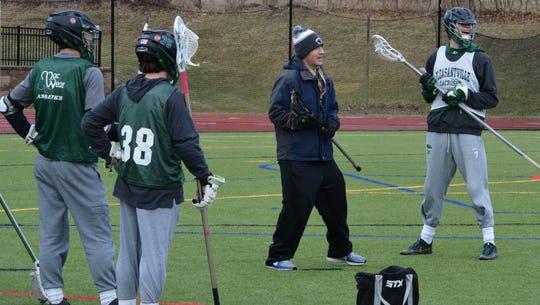 Pleasantville head coach Chris Kear sets up a drill