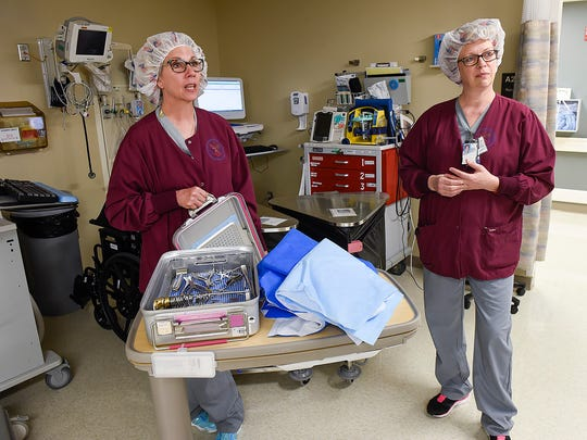 Jody Wessel, certified surgical technician, and Brenda Shoenberg, operating room nurse, show reusable sterilization container Thursday, June 8, at the St. Cloud VA Health Care System. Previously surgical tools were wrapped in blue plastic which was not recyclable or reusable.