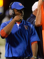 Woodlawn head coach Jerwin Wilson walks the sideline as his team takes on North DeSoto.