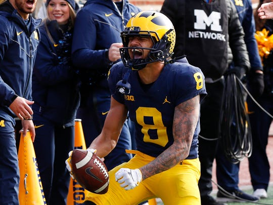 Michigan wide receiver Ronnie Bell (8) reacts after a reception against Michigan State in the first half of an NCAA college football game in Ann Arbor, Mich., Saturday, Nov. 16, 2019. (AP Photo/Paul Sancya)