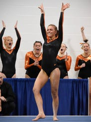 Tech's Jodi Lipp competes on the floor exercise during