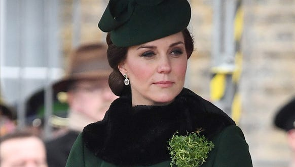 Kate accessorized her Catherine Walker coat with a