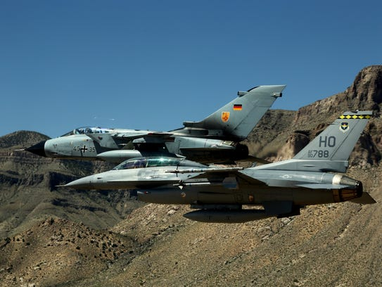 A German air force Tornado and an F-16 Fighting Falcon