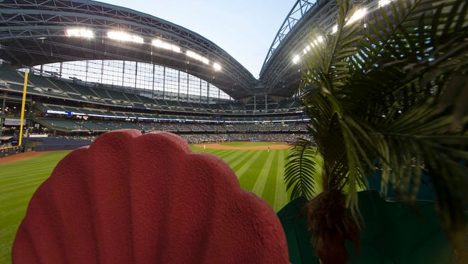 """Tropical decorations lend a bit of a South Florida flavor to Miller Park, where the Miami Marlins opened their  """"home"""" series against the Brewers in the wake of Hurricane Irma."""