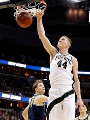 Purdue center Isaac Haas (44) dunks in front of Michigan