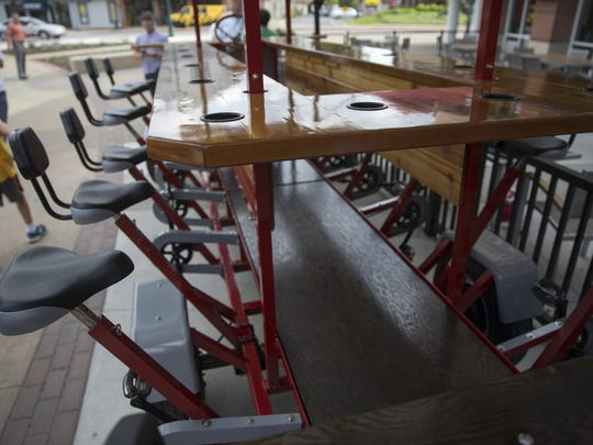 The Pint Cycle, a newly started 16-person bicycle modeled after other area rigs that let participants ride around the downtown Fishers hub and try an expanding list of eating and drinking establishments, Tuesday, June 7, 2016.