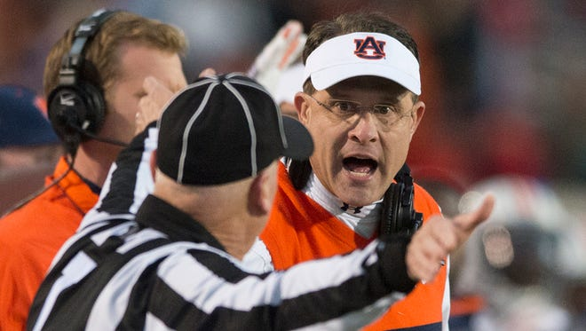 Auburn head coach Gus Malzahn yells at a referee during the NCAA football game between Auburn and Mississippi at University of Mississippi in Oxford, Miss., on Saturday, Nov. 1, 2014.