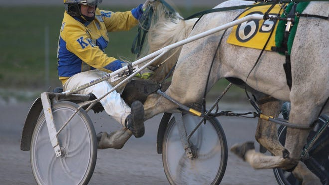 A harness racer works his horse at Northville Downs. The track is one of only two racing venues in Michigan.