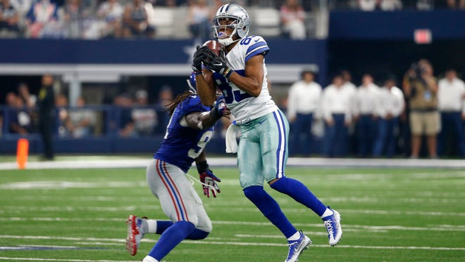 New York Giants linebacker Kelvin Sheppard (91) defends as Dallas Cowboys wide receiver Terrance Williams (83) catches a pass in the second half of an NFL football game, Sunday Sept. 11,  2016, in Arlington, Texas.