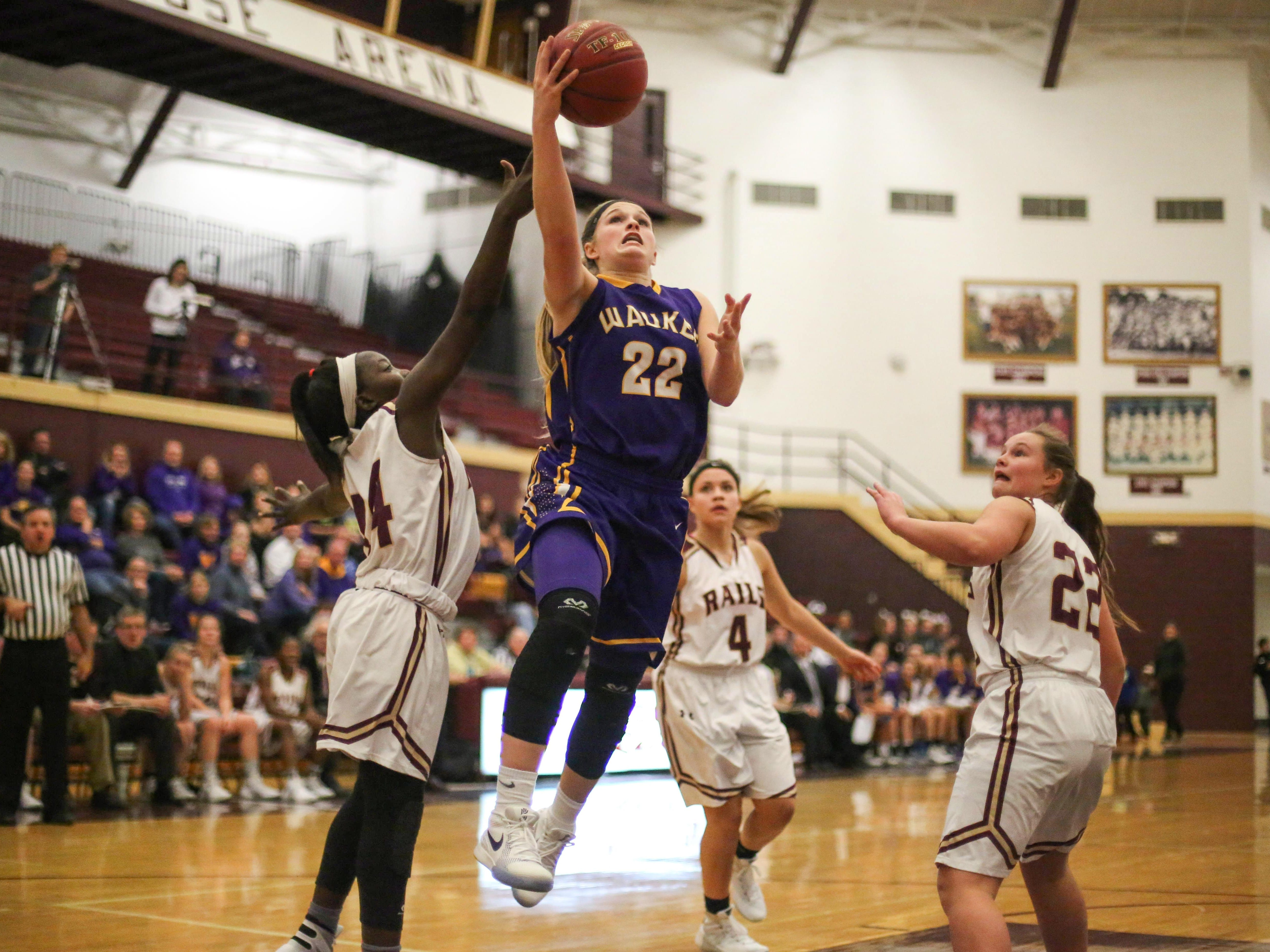 Waukee junior Callie Littlefield drives to the hoop against Lincoln on Tuesday. Littlefield scored a game-high 18 points, and the Warriors cruised to an 80-25 victory.