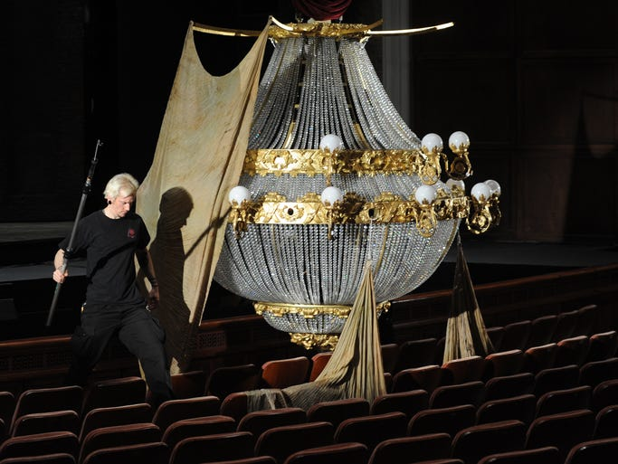 The crew for The Phantom of the Opera, playing at The Peace Center, prepares the chandelier for the first performance on Thursday, May 15, 2014.