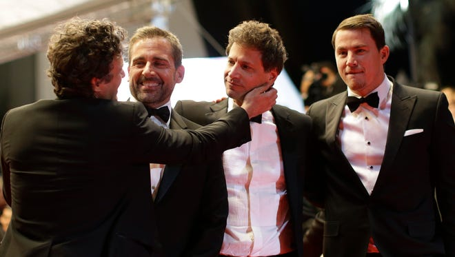 """Mark Ruffalo, left, Steve Carell, director Bennett Miller and Channing Tatum leave after the screening of """"Foxcatcher"""" at Cannes."""