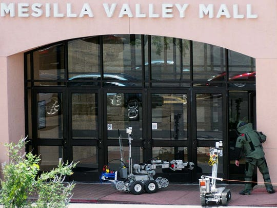 Doñ–a Ana County Sheriff's bomb squad utilizes robots while investigating a suspicious package Aug. 6, 2015, that was left at the east-side entrance of the Mesilla Valley Mall.
