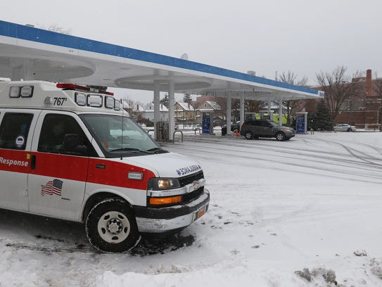 An ambulance stages in the area of Lake and Ridgeway