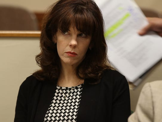 Laura Rideout watches as the prosecution gets up to