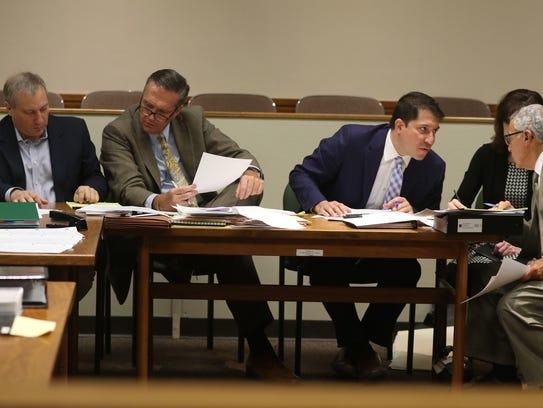 Paul Tucci confers with his attorney, Michael Schiano,