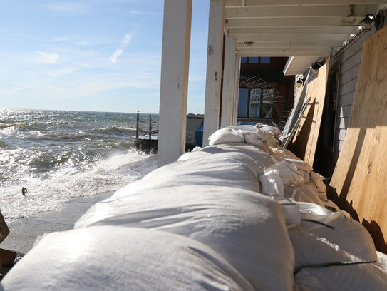 The waves have pounded this home on Edgemere Drive