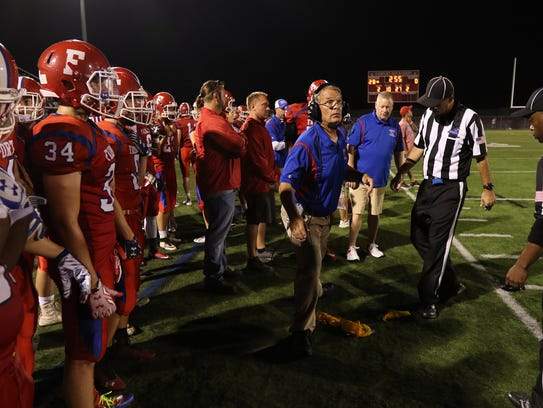 Fairport head coach Dave Whitcomb looks up. Both sides